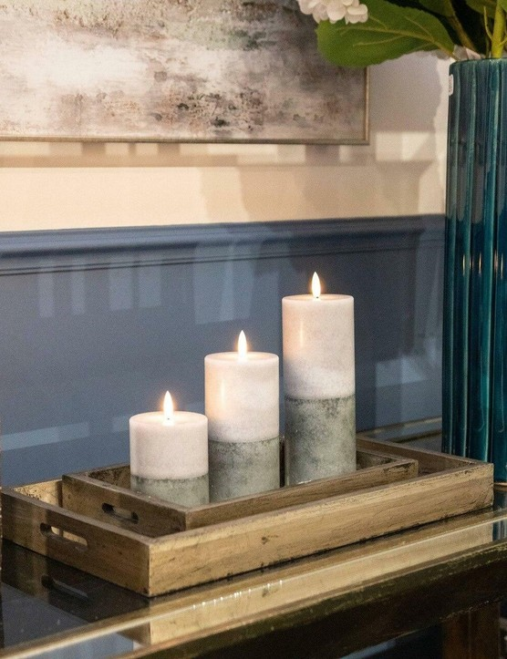 Place your candles inside a rustic wooden tray to make an interesting decorative feature. Image credit: MoochZilla