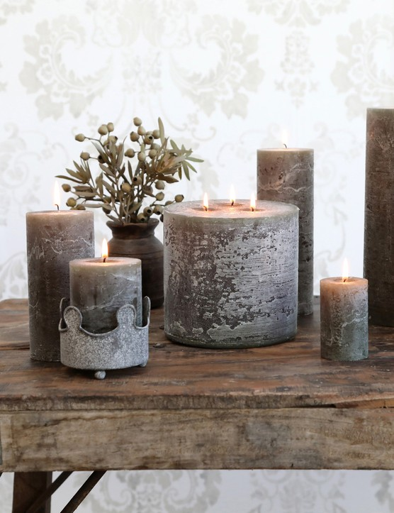 Natural-toned, textured candles look great styled on rustic wooden furniture. Image credit: Heavenly Homes and Gardens