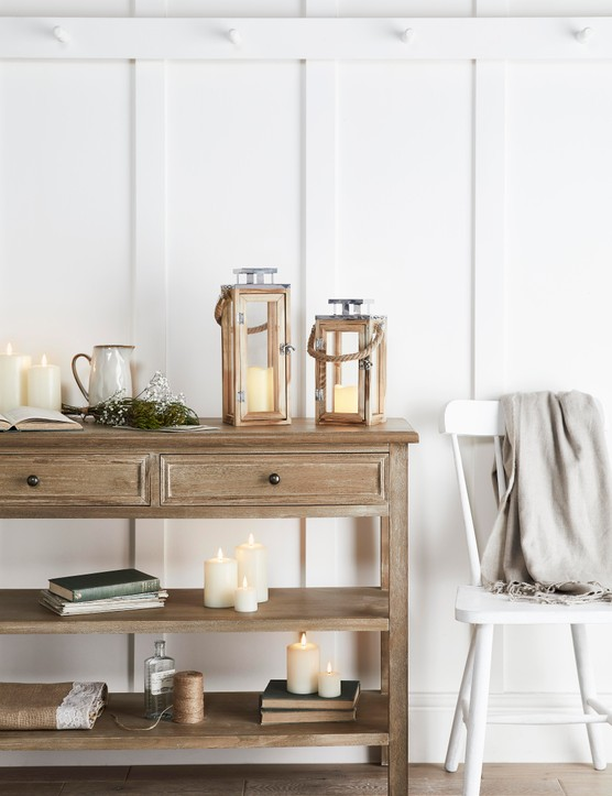 Fill hurricane lanterns with simple white pillar candles for a classic look. Image credit: Lights4Fun