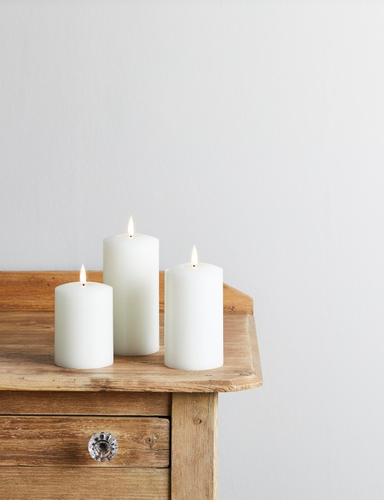 Spruce up a desk, mantelpiece or console table with a trio of pillar candles. Image credit: Lights4Fun