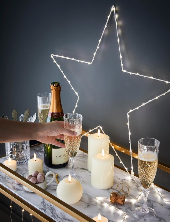 Pillar candles, in all shapes and sizes, make a great addition to a bar cart. Image credit: Lights4Fun