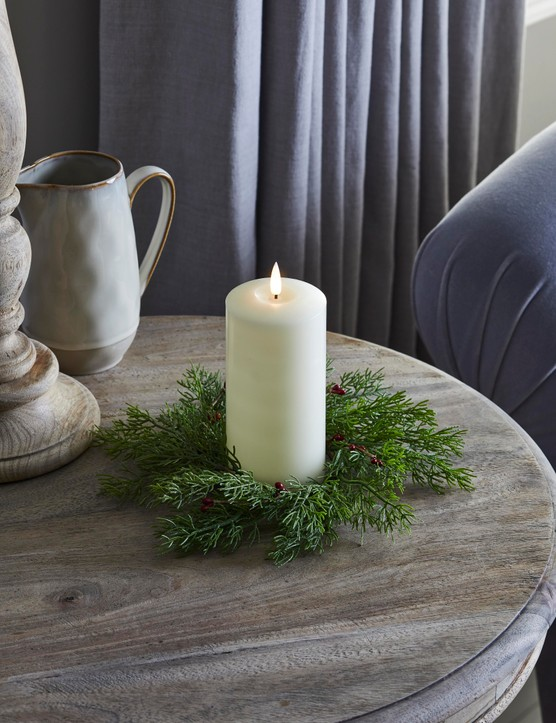 A single candle inside a seasonal wreath will make a simple but effective centrepiece. Image credit: Lights4Fun