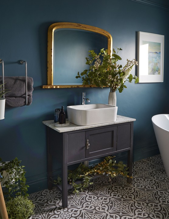 Painting the walls a sumptuous teal and adding a revamped vanity unit gave Gillian's bathroom a luxury spa feel within her budget
