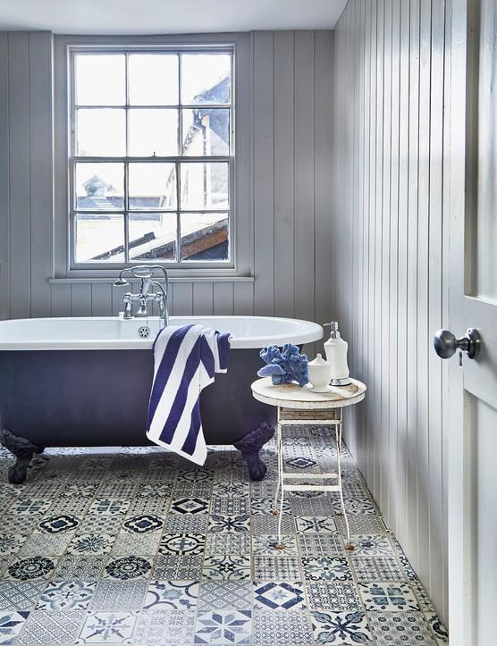 Starfloor Retro Indigo luxury vinyl tiles, £34.99 per sq m, Carpetright
