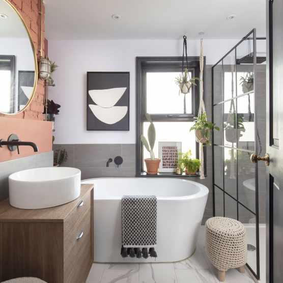 The family bathroom has been given a modern-industrial look, with a free-standing bath and walk-in shower enclosure. The Crittall-style shower screen, from Bathstore, ties in with the matt black fixtures and fittings