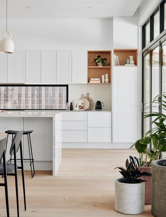 Scandi style is perfect for a kitchen - simply opt for plain, white cabinets and add plenty of natural accents. Image credit: Circu