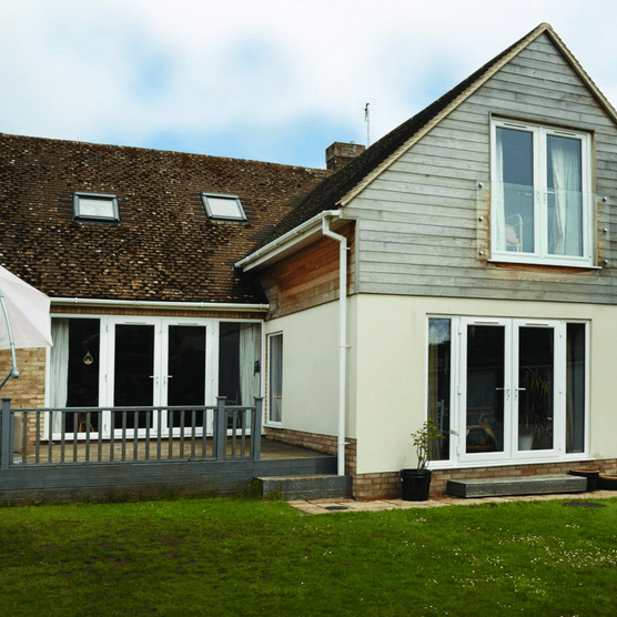 The couple's once-dated bungalow has been given a new look outside and in, with a remodelled layout that works for their family