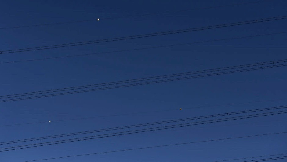 What are the coloured balls that are attached to power lines for? © Getty Images