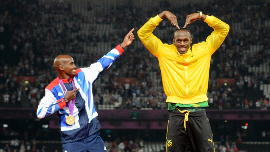 Jamaica's 4X100 relay gold medalist Usain Bolt (R) and Britain's 5000m gold medalist Mohamed Farah pose after the athletics event during the London 2012 Olympic Games on August 11, 2012 in London © Johannes Eisele/AFP/GettyImages