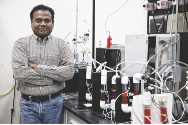 Dr Pratap C Pullammanappallil with a device to turn faeces into fuel © Amy Stuart/UF IFAS Communications