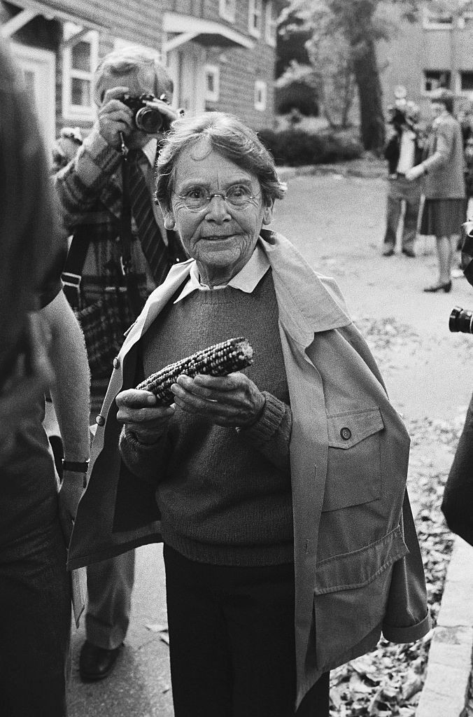 Barbara McClintock, Nobel Prize-winning geneticist, holding an ear of corn © Bettmann/Getty Images