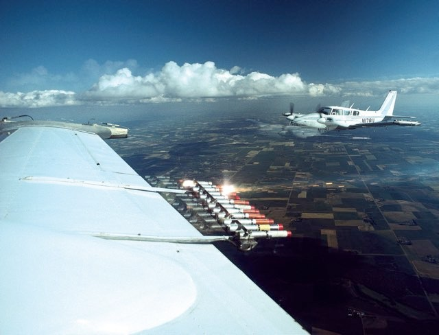 Cloud- seeding substances, which provide nuclei around which clouds can precipitate, being blasted from a plane © WEBB CHAPPELL, FLPA