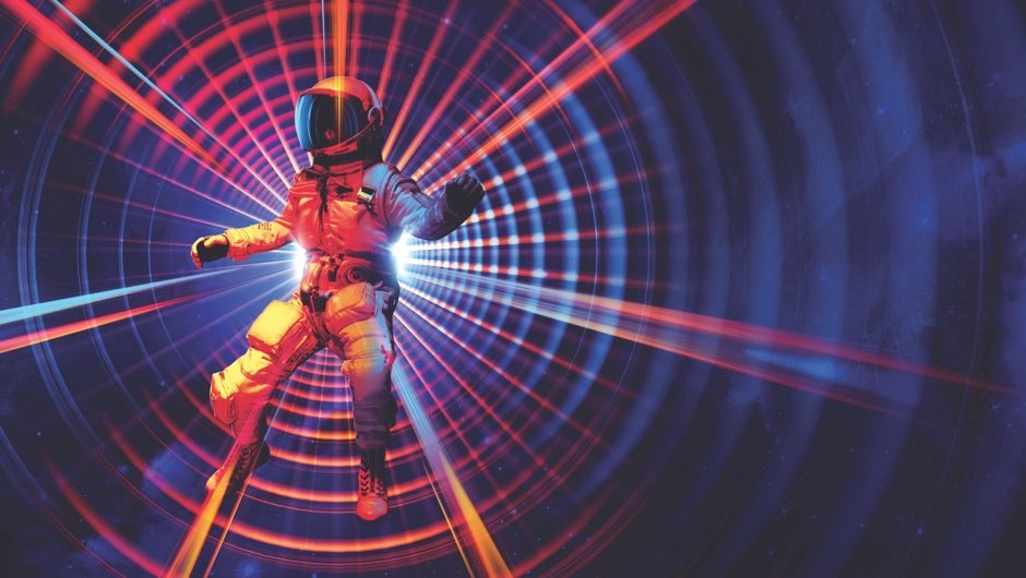 Wormholes: Could we travel through a black hole into another galaxy?