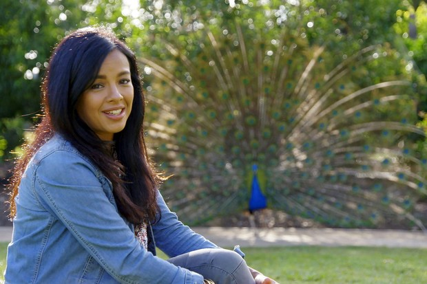 Liz Bonnin with displaying male peacock © BBC NHU