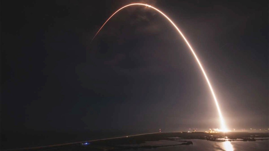 Why is a rocket trajectory curved after launch?