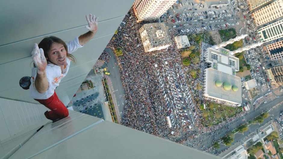 French climber Alain Robert, aka Spider-Man, climbing a 448m-high building in 2007 (© Getty Images)