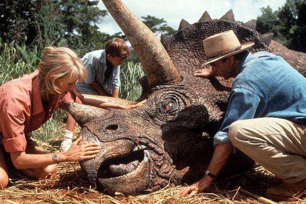 Laura Dern and Sam Neill come to the aid of a triceratops in a scene from the film 'Jurassic Park', 1993 © Universal/Getty Images
