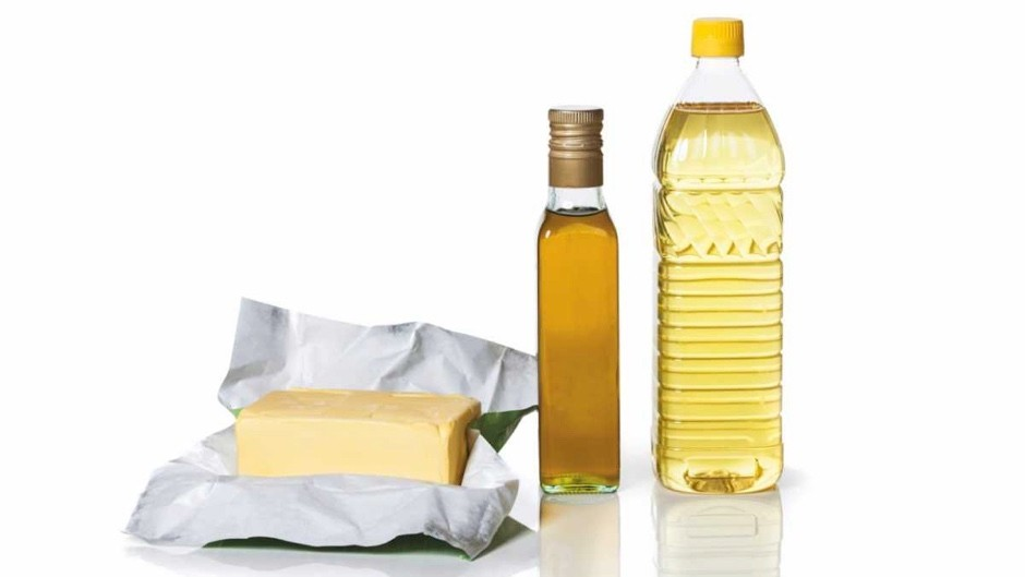 Why are fats solid at room temperature but oils liquid?
