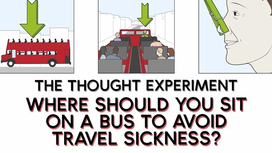Where should you sit on a bus to avoid travel sickness?