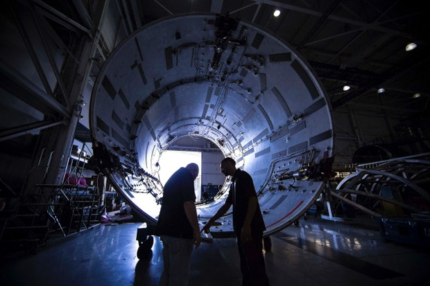 SpaceX engineers inspect one of the Falcon 9's interstage sections prior to assembly © SpaceX