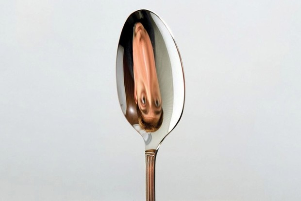 Why is your reflection upside-down in a spoon?