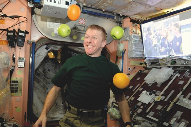A fresh fruit arrival is greeted with delight by Tim Peake on the ISS © ESA