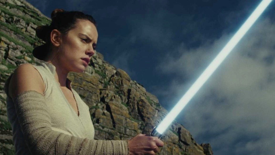 Rey in Star Wars: The Last Jedi wielding an impossible to create (as far as we know) lightsaber © 2017 Lucasfilm Ltd.