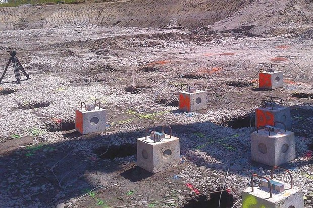 Sensors sitting on top of concrete blocks measure how boreholes drilled into the ground can affect seismic energy © Nova