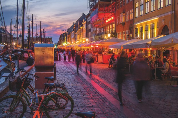 Denmark's capital city of Copenhagen, where residents commute by bicycle and there's always time for a cinnamon bun. What's not to love? © Getty