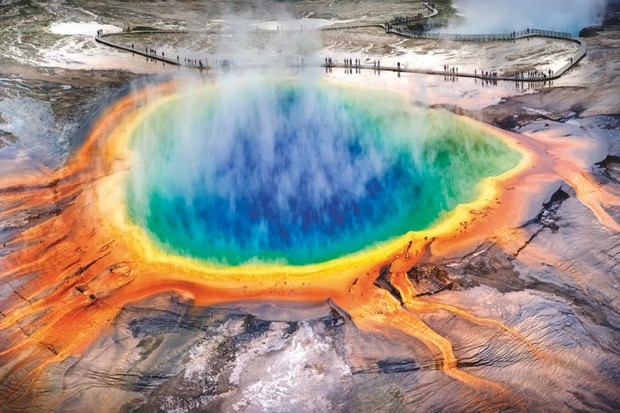 Springs and geysers at Yellowstone, like the Grand Prismatic Spring pictured here, hint at the volcanic activity below ground © Getty Images