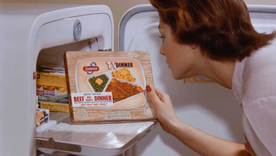 A woman examines a TV dinner box she has taken from the freezer © William Gottlieb/CORBIS/Corbis via Getty Images