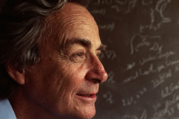 Nobel Prize winning physicist Richard Feynman stands in front of a blackboard strewn with notation in his lab in Los Angeles, Californina. (Photo by Kevin Fleming/Corbis via Getty Images)