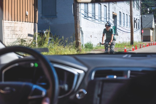 Cyclists ride on roads and pavements, which can confuse the technology in autonomous cars © Getty Images
