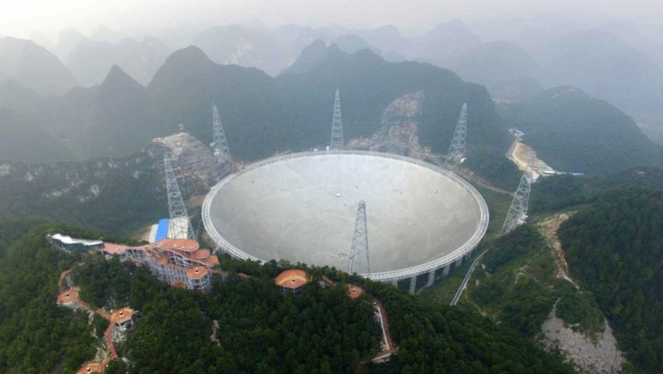 Aerial view of the Five-hundred-meter Aperture Spherical radio Telescope (FAST), Guizhou Province of China © VCG/Getty Images