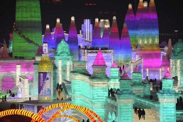 An illuminated ice castle during the Harbin International Ice and Snow Sculpture Festival in Harbin, China © Stringer/Anadolu Agency/Getty Images