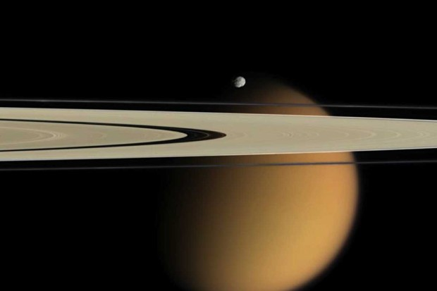 Saturn moon Epimethus with Titan in the background © NASA