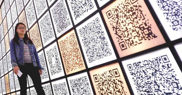 How do QR codes differ from barcodes?