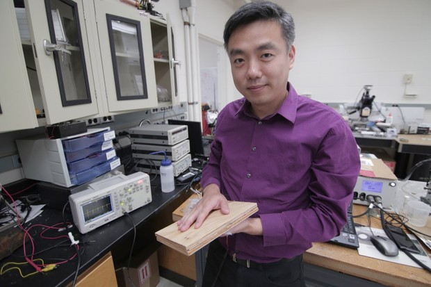 Associate Professor Xudong Wang holds a prototype of the researchers' energyharvesting technology, which uses wood pulp and harnesses nano fibers © Stephanie Precourt/UW-Madison College of Engineering