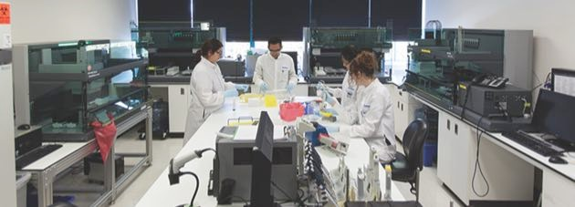 23andMe scientists working in the lab © 23andMe