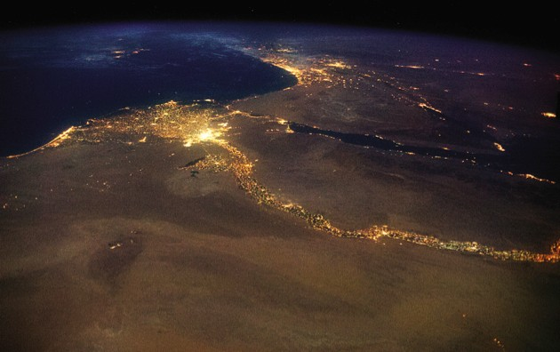 """The Nile, draining out to the Mediterranean. The bright lights of Cairo announce the opening of the north-flowing river's delta, with Jerusalem's answering high beams to the northeast."""""""