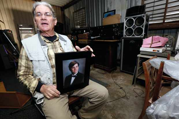 Michael Usry Sr with a picture of his then 19-year-old son. Usry Jr was vilified online as a murderer due to partial DNA evidence, but was later found innocent © Shutterstock
