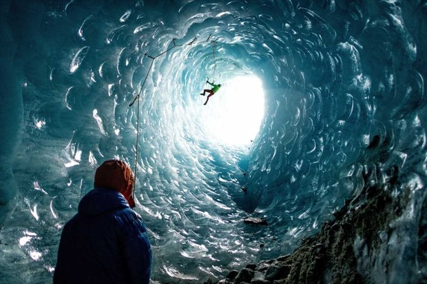 Climbers climb a cylindrical ice cave, France © Mathis Dumas/Solent News/Shutterstock