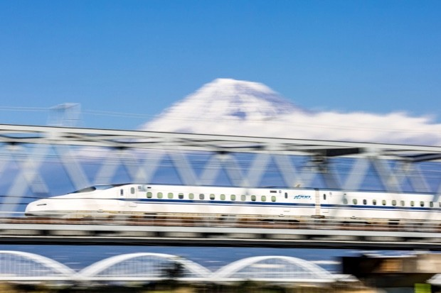 The Shinkansen bullet train zipping past Mt Fuji with its destinctive, kingfisher-inspired nose © Getty
