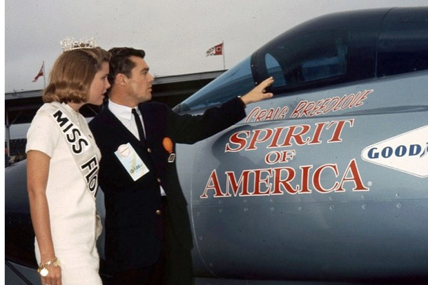 """Craig Breedlove shows the cockpit of his """"Spirit of America"""" to Miss Florida during pre-race activities for the Daytona 500 NASCAR Cup race at Daytona International Speedway (ISC Images & Archives via Getty Images)"""