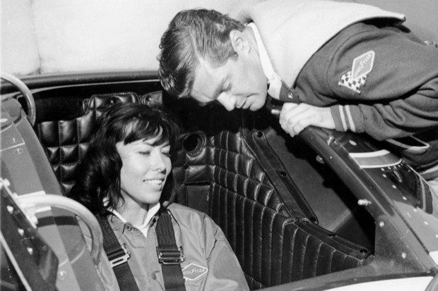 Craig Breedlove explaining the controls of his Spirit of America - Sonic I car to his wife, Lee, 1965 (National Motor Museum/Heritage Images/Getty Images)
