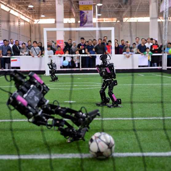 Robots play football during the 13th international RoboCup competition at Tehran International Fair, Iran © Fatemeh Bahrami/Anadolu Agency/Getty Images
