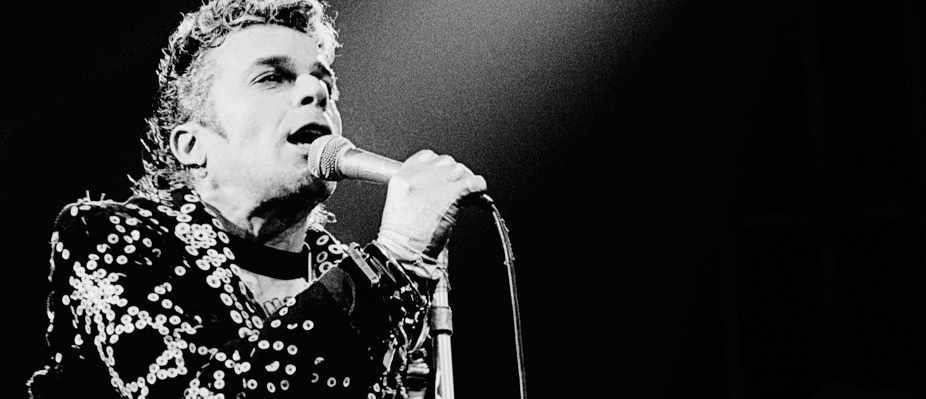 Ian Dury performs live on stage in London in 1979 (Photo by Gus Stewart/Redferns)