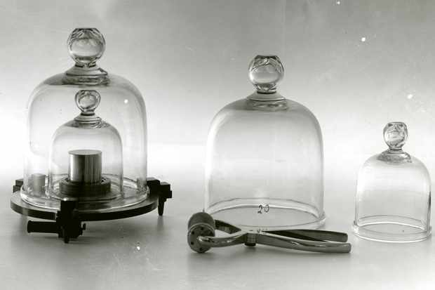 The platinum-iridium cylinder (right) was the primary standard kilogram for all metric measurements in the U. S. Known as Kilogram No. 20, it was a copy of the International Prototype Kilogram, which was preserved at the  International Bureau of Weights and Measures at Sevres, France. Kilogram No. 4 (left, under double bell jar), a duplicate of No. 20, was used as a secondary standard. Noth cylinders were 39 mm in diameter and 39 mm. high; they were made of 90 percent platinum and 10 percent iridium. Re-comparison of Kilogram No. 20 with the international standard in 1937 showed that the United States standard had changed by only one part in 50 million during approximately 50 years.