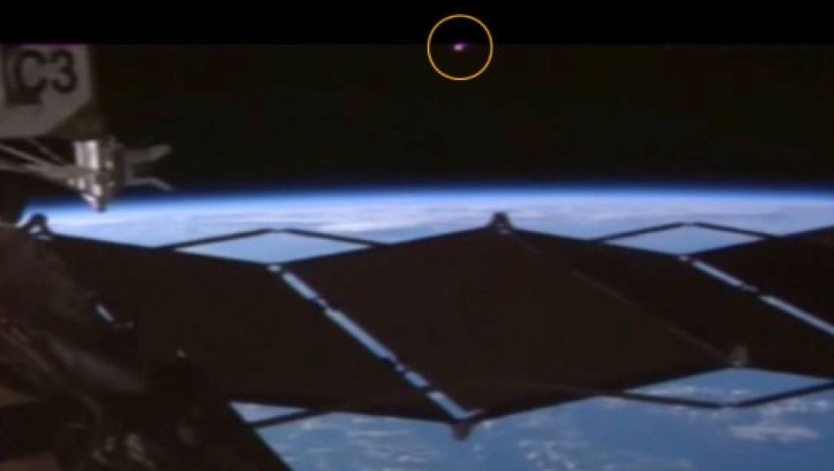 Is a mysterious pink UFO watching the International Space Station? © YouTube