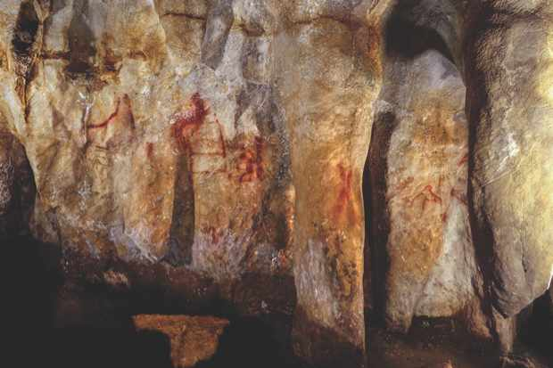 Cave art in La Pasiega, Spain, was daubed on the walls by Neanderthals some 64,000 years ago © P Saura